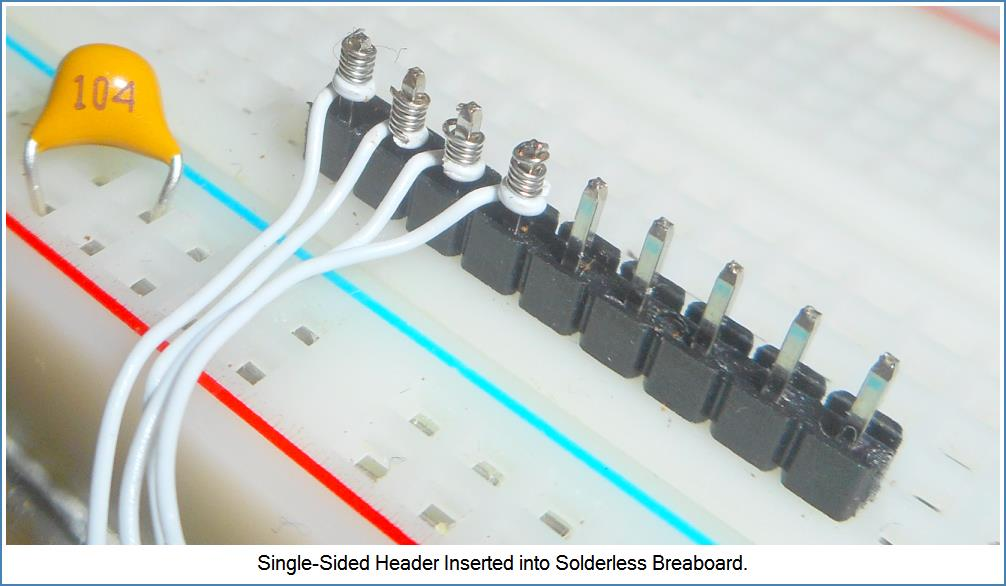 Example of how wire-wrap looks on header inserted into Solderless Breadboard.