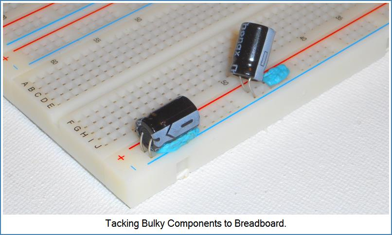 Image shows how to attach bulky component to Breadboard...